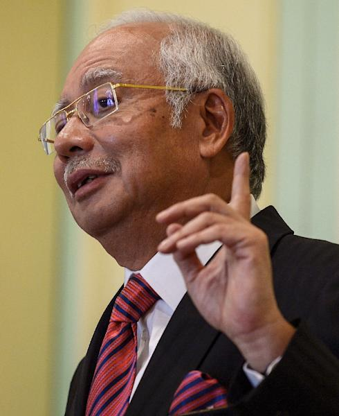 Malaysia's Prime Minister Najib Razak has been under fire since the Wall Street Journal last month published Malaysian documents showing nearly $700 million had been deposited into his personal bank accounts (AFP Photo/Mohd Rasfan)