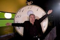 """FILE PHOTO: Former Monty Python star Jones gestures in front of """"time machine"""" before interview in Lisbon"""