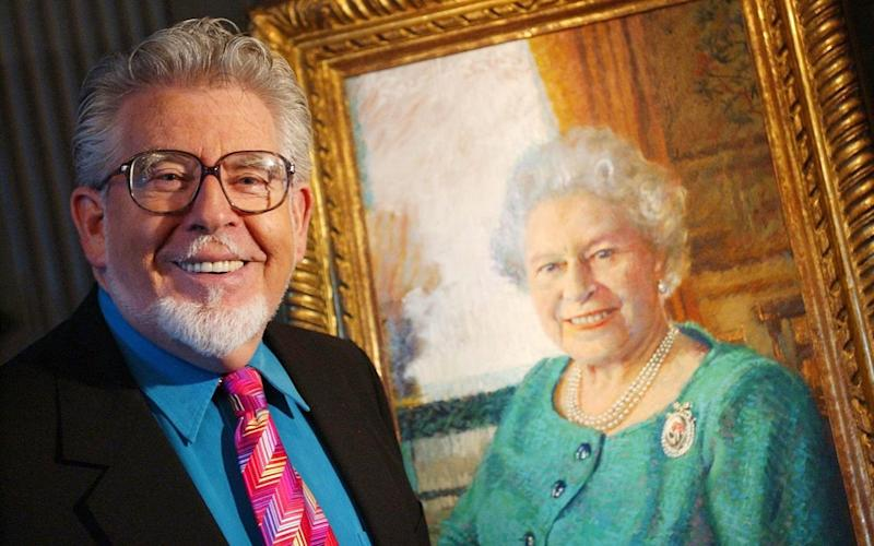 Rolf Harris was one of the country's best loved entertainers - Credit: PA