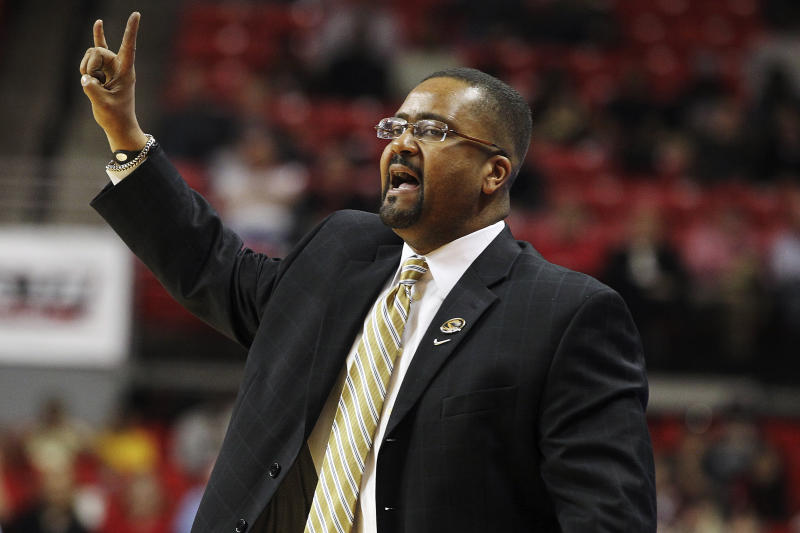 Missouri coach Frank Haith signals to his team against Texas Tech during their NCAA college basketball game in Lubbock, Texas, Saturday, March 3, 2012. (AP Photo/The Avalanche-Journal, Zach Long) ALL LOCAL TV OUT