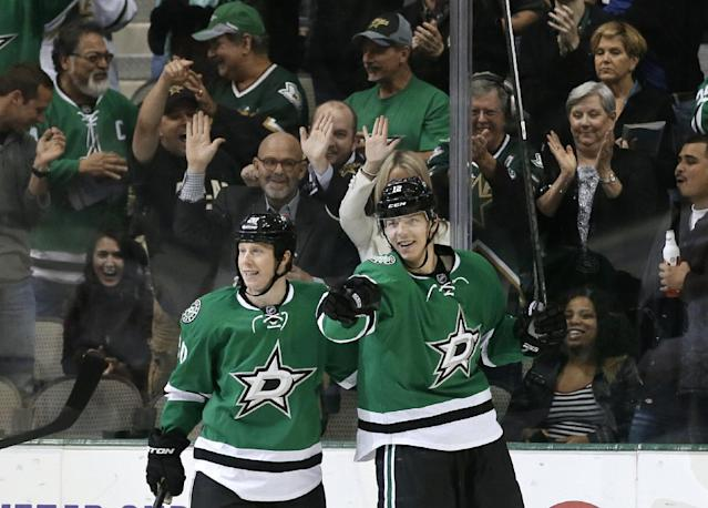 Dallas Stars' Cody Eakin, left, celebrates with right wing Alex Chiasson, right, following Chiasson's goal in the first period of an NHL hockey game against the Calgary Flames, Thursday, Oct. 24, 2013, in Dallas. (AP Photo/Tony Gutierrez)