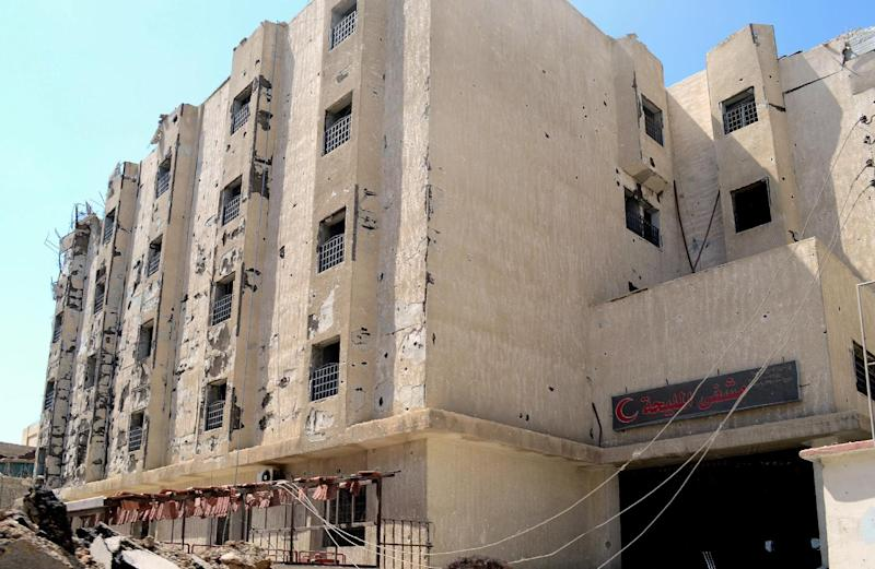 A picture released by the official Syrian Arab News Agency on August 14, 2014, shows the damaged Mleiha Hospital building on the outskirts of Damascus (AFP Photo/)