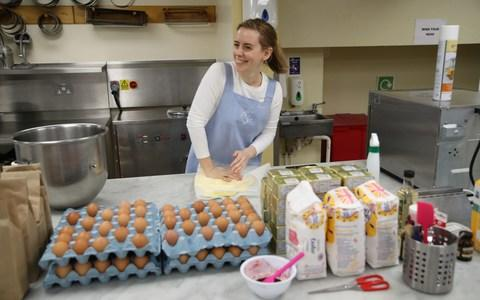 Sophie Cabot preparing and baking parts of Princess Eugenie's red velvet and chocolate wedding cake  - Credit: PA