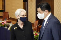 U.S. Deputy Secretary of State Wendy Sherman, left, and South Korean First Vice Foreign Minister Choi Jong Kun, right, walk in the meeting venue with Japanese Vice-Minister for Foreign Affairs Takeo Mori prior to their trilateral meeting at the Iikura Guesthouse Wednesday, July 21, 2021, in Tokyo. (AP Photo/Eugene Hoshiko)