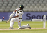 Pakistan's Shan Masood hits a six during the second day of the first cricket Test match between England and Pakistan at Old Trafford in Manchester, England, Thursday, Aug. 6, 2020. (Lee Smith/Pool via AP)