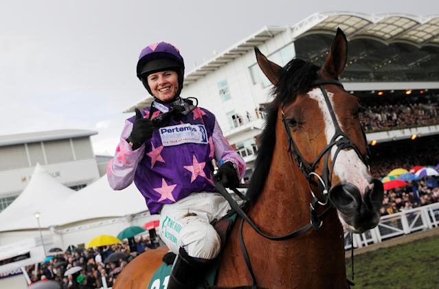Horse Racing - Cheltenham Festival - Cheltenham Racecourse, Cheltenham, Britain - March 16, 2018 Bridget Andrews on Mohaayed celebrates after winning the 14.10 Randox Health County Handicap Hurdle REUTERS/Darren Staples