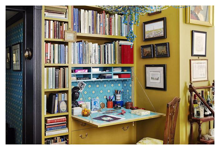 """<p>A DIY or custom fold-out desk is the best option for tiny work-from-home spaces where additional furniture just isn't in the cards. <a href=""""https://brockschmidtandcoleman.com/"""" rel=""""nofollow noopener"""" target=""""_blank"""" data-ylk=""""slk:Brockschmidt and Coleman"""" class=""""link rapid-noclick-resp"""">Brockschmidt and Coleman</a> customized this built-in bookshelf with a fold-out desk so that work could be hidden at the end of the day. Out of sight, out of mind—and out of the way.</p>"""