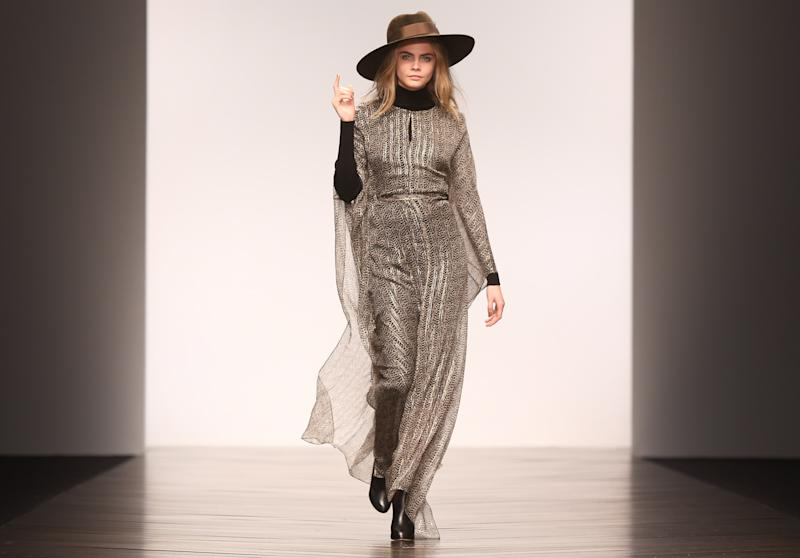 British model Cara Delevingne shows a creation by designer Issa during London Fashion Week, at Somerset House in central London, Saturday, Feb. 16, 2013. (Photo by Joel Ryan/Invision/AP)