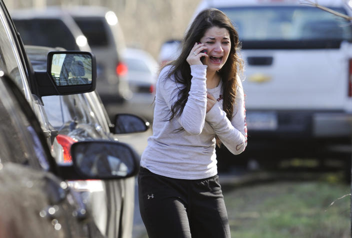 Carlee Soto uses a phone to ask about her sister, Victoria Soto, a teacher at the Sandy Hook Elementary School in Newtown, Conn. on Dec. 14, 2012, after gunman Adam Lanza killed 26 people inside the school, including 20 children. Victoria Soto, 27, was among those killed. (Photo: Jessica Hill/AP)