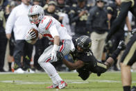 Ohio State wide receiver Frank Epitropoulos, left, is tackled by Purdue defensive back Frankie Williams during the second half of an NCAA college football game in West Lafayette, Ind., Saturday, Nov. 2, 2013. Ohio State defeated Purdue 56-0. (AP Photo/Michael Conroy)