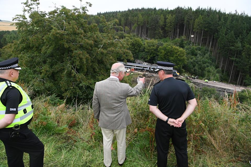 The Prince of Wales views the scene at Stonehaven tfollowing the ScotRail train derailment near Stonehaven, Aberdeenshire, which cost the lives of three people.