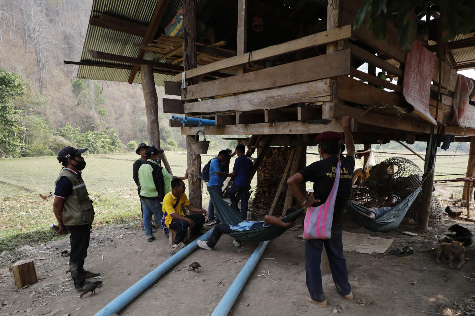 Thai villagers visit a checkpoint of the Thai Rangers in Mae Sakoep village in Mae Hong Son province, Thailand, Monday, March 29, 2021, where people from neighboring Myanmar arrived after they had fled from their homes, following airstrikes by Myanmar's military. (AP Photo/Sakchai Lalit)