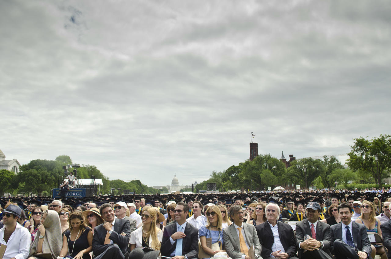 WASHINGTON, DC - MAY 20: People attend the 2012 George Washington University Commencement at National Mall on May 20, 2012 in Washington, DC. (Photo by Kris Connor/Getty Images)