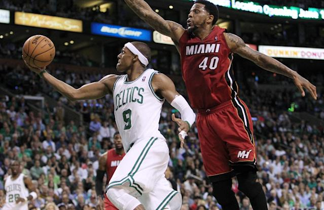 Boston Celtics' Rajon Rondo (9) drives past Miami Heat forward Udonis Haslem (40) during the second quarter in Game 6 of the NBA basketball Eastern Conference finals, Thursday, June 7, 2012, in Boston. (AP Photo/Elise Amendola)