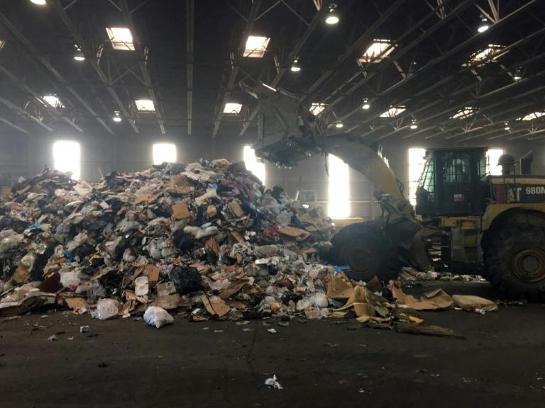 At the Fort Totten Transfer Station in Washington, trash is piled up before being taken by truck to a factory where it is incinerated