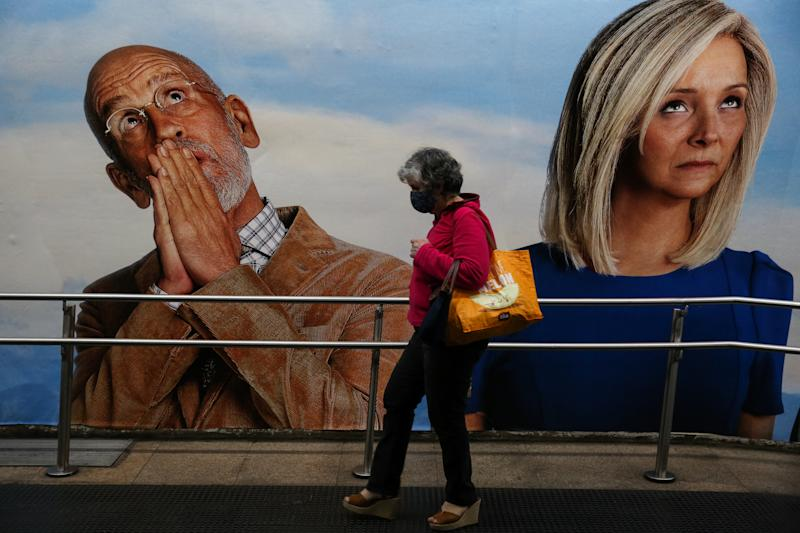 SAO PAULO, BRAZIL - JUNE 29: A woman wearing a face mask walks in a subway station in downtown Sao Paulo amidst the coronavirus (COVID-19) pandemic on June 29, 2020 in Sao Paulo, Brazil. The city of Sao Paulo moves to the Yellow phase of quarantine easing, in which commercial establishments can operate following distance rules such as reduced opening hours, restricting the flow of people and maintaining hygiene standards. (Photo by Alexandre Schneider/Getty Images)