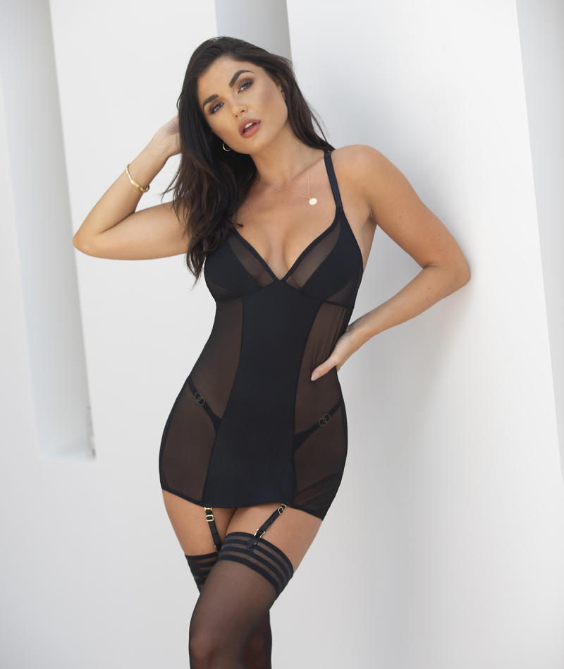 Woman in lingerie brand Pour Moi wearing bodysuit and stockings
