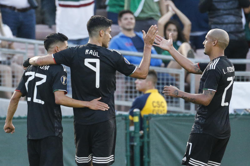 CORRECT TO URIEL ANTUNA, INSTEAD OF JORGE SANCHEZ - Mexico forward Raul Jimenez (9) celebrates his goal with Uriel Antuna (22) and Luis Rodriguez (21) during the first half of a CONCACAF Gold Cup soccer match against Cuba in Pasadena, Calif., Saturday, June 15, 2019. (AP Photo/Ringo H.W. Chiu)
