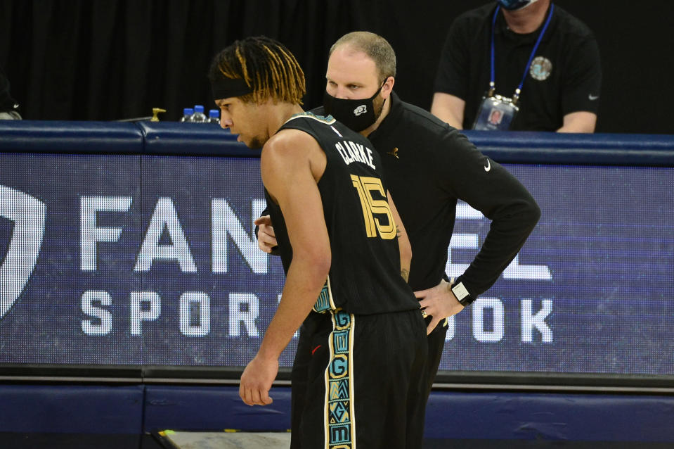 Memphis Grizzlies head coach Taylor Jenkins, front right, talks with forward Brandon Clarke (15) in the first half of an NBA basketball game against the Phoenix Suns, Monday, Jan. 18, 2021, in Memphis, Tenn. (AP Photo/Brandon Dill)