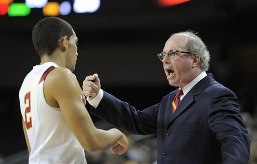 Southern California coach Kevin O'Neill, right, talks to guard Greg Allen during the first half of an NCAA college basketball game against Colorado, Thursday, Jan. 26, 2012, in Los Angeles. (AP Photo/Mark J. Terrill)