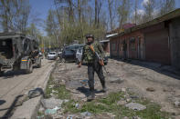 Indian army officers arrive at the site of a shootout on the outskirts of Srinagar, Indian controlled Kashmir, Thursday, April 1, 2021. Gunmen in disputed Kashmir on Thursday killed a policeman as they tried to storm the residence of a politician of India's ruling party, police said. (AP Photo/ Dar Yasin)