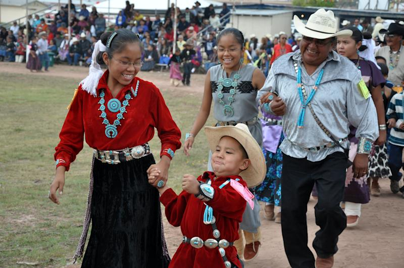 This undated image provided by the Navajo Tourism Department shows tribal members participating in the social song and dance competition during the 2011 Navajo Nation Fair in Window Rock, Ariz. An economic impact study and yearlong survey show spending by tourists on the Navajo Nation has increased by nearly one-third since 2002. (AP Photo/Navajo Tourism Department, Roberta John)