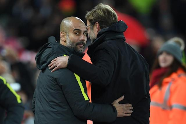 Liverpool manager Jurgen Klopp (right) has voiced his support for Manchester City boss Pep Guardiola ahead of their Premier League meeting (AFP Photo/Paul ELLIS)