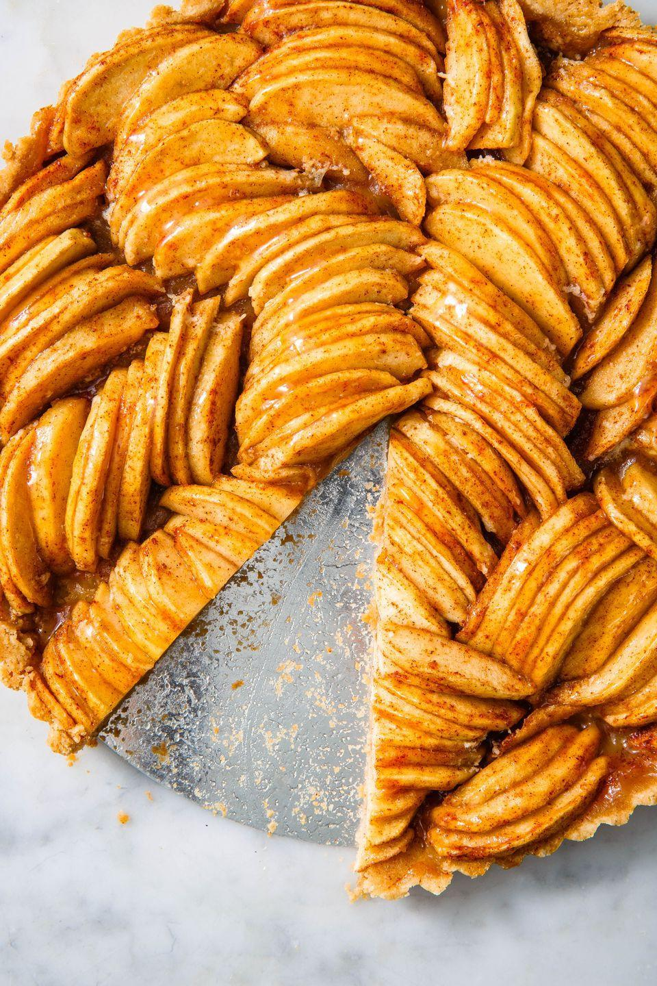 """<p>An apple tart worthy of your Thanksgiving table. </p><p>Get the recipe from <a href=""""https://www.delish.com/cooking/recipe-ideas/a23364812/apple-tart-recipe/"""" rel=""""nofollow noopener"""" target=""""_blank"""" data-ylk=""""slk:Delish"""" class=""""link rapid-noclick-resp"""">Delish</a>. </p>"""