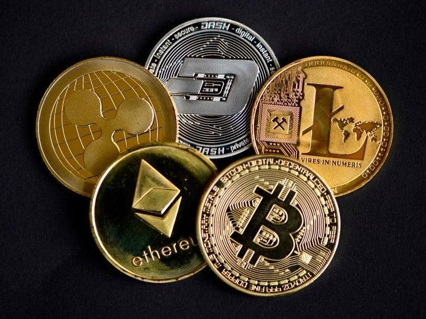 <p>A crypto market cool off in May has seen many of the gains made by bitcoin, ethereum and other cryptocurrencies in 2021 wiped away</p> (AFP via Getty Images)