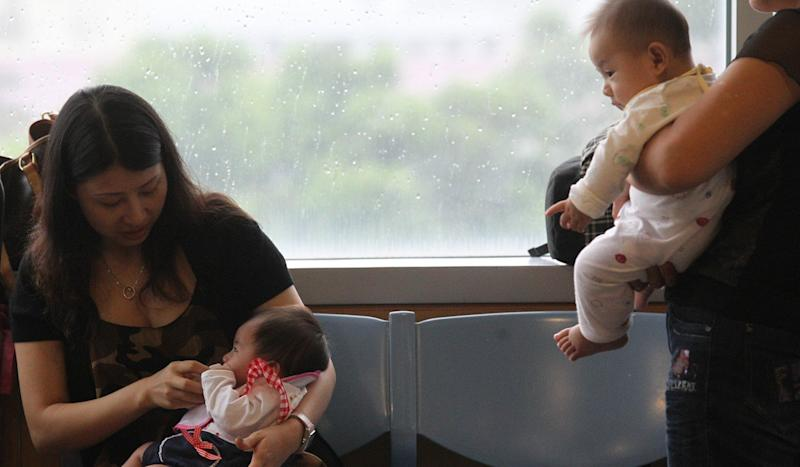 Pay Hong Kong bosses the cost of extra month's maternity leave, former government adviser urges