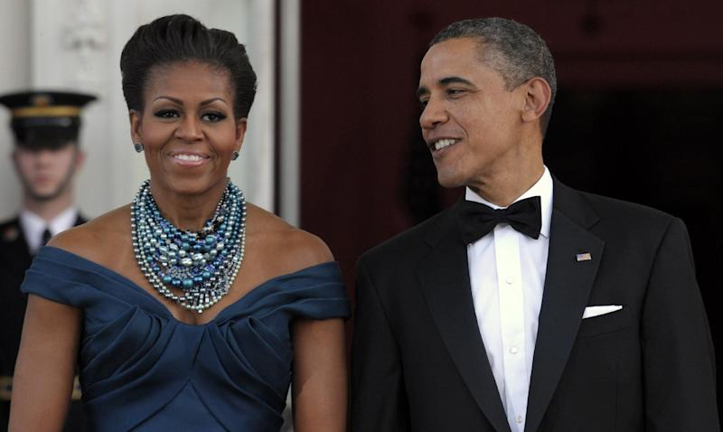 President Barack Obama and first lady Michelle Obama wait to welcome Britain's Prime Minister David Cameron and his wife Samantha Cameron to the White House prior to a State Dinner, Wednesday, March 14, 2012, in Washington. (AP Photo/Susan Walsh)