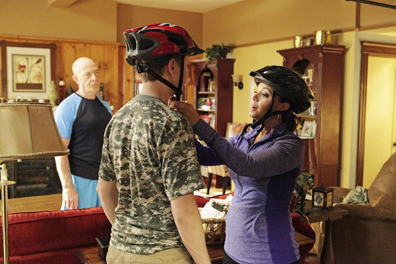"""This undated publicity photo released by ABC shows, from left, J.K. Simmons, Johnny Pemberton and Leah Remini in a scene from the episode """"Beachwood Approved"""" from the ABC Television Network's series, """"Family Tools,"""" airing Wednesday, May 15, 8:30 p.m., ET. Remini stars in the sitcom which debuts May 1, 2013. (AP Photo/ABC, Nicole Wilder)"""