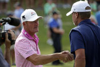 Alex Cejka, left, of Germany, shakes hands with Steve Stricker after winning on the first hole of a playoff after the final round of the PGA Tour Champions Regions Tradition golf tournament Sunday, May 9, 2021, in Hoover, Ala. (AP Photo/Butch Dill)