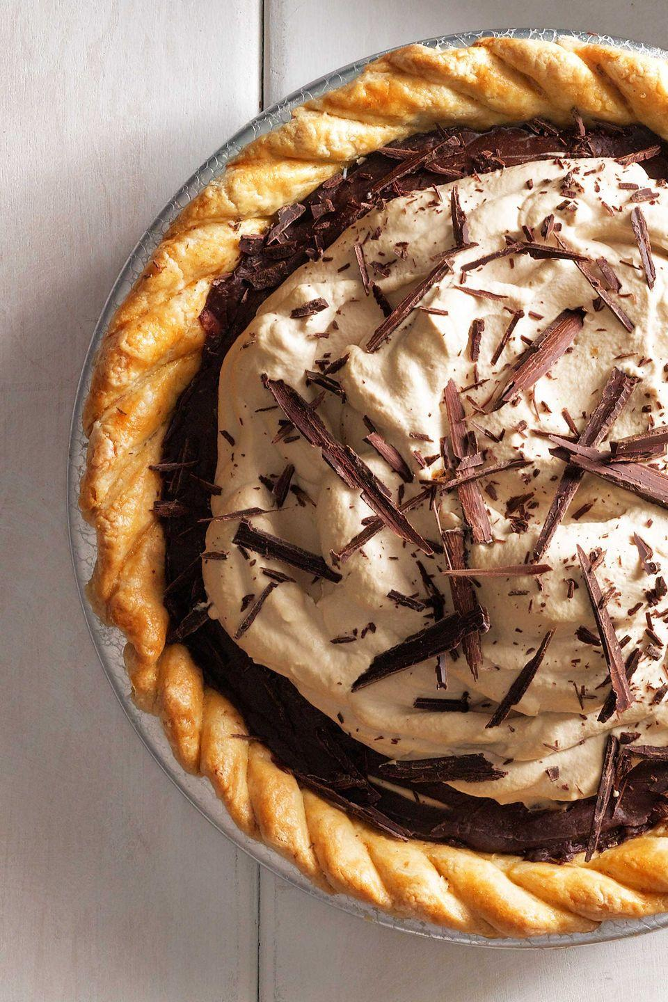 """<p>This pie is inspired by Anna Jones's winning pie at the 2013 state fair of Texas. </p><p><strong><a href=""""https://www.countryliving.com/food-drinks/recipes/a5618/decadent-chocolate-espresso-pie-recipe-clx0914/"""" rel=""""nofollow noopener"""" target=""""_blank"""" data-ylk=""""slk:Get the recipe"""" class=""""link rapid-noclick-resp"""">Get the recipe</a>.</strong></p>"""