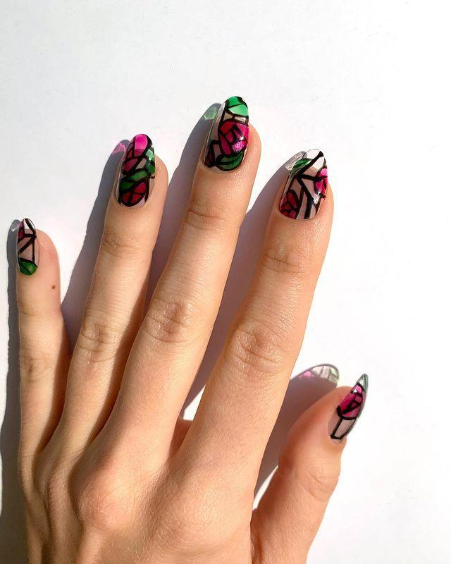"""<p>A stained glass manicure, like this one from Jessica Washick, gives the notion of flowers and roses in a format that will get you more likes and comments than you thought possible. </p><p><a href=""""https://www.instagram.com/p/B5GPe5ZHarE/"""" rel=""""nofollow noopener"""" target=""""_blank"""" data-ylk=""""slk:See the original post on Instagram"""" class=""""link rapid-noclick-resp"""">See the original post on Instagram</a></p>"""