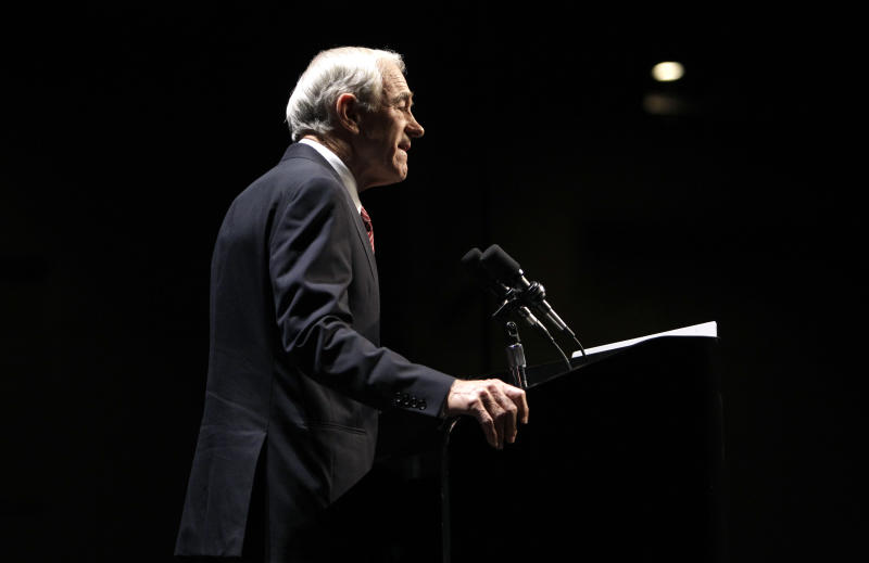 Republican presidential hopeful U.S. Rep. Ron Paul, R-Texas, speaks during the Iowa Republican Party's Ronald Reagan Dinner, Friday, Nov. 4, 2011, in Des Moines, Iowa.  Paul decried Washington's spending and the nation's military actions abroad in his remarks. (AP Photo/Charlie Neibergall)