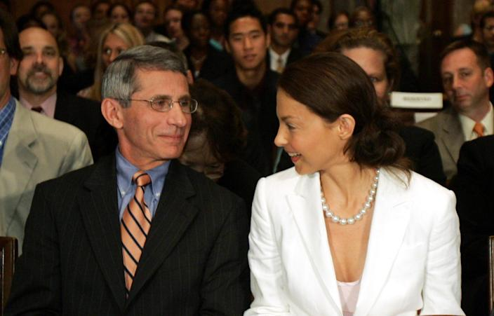 Fauci with actress Ashley Judd prior to giving their testimony before the Senate Foreign Relations Committee, June 23, 2005. (Susan Walsh/AP)