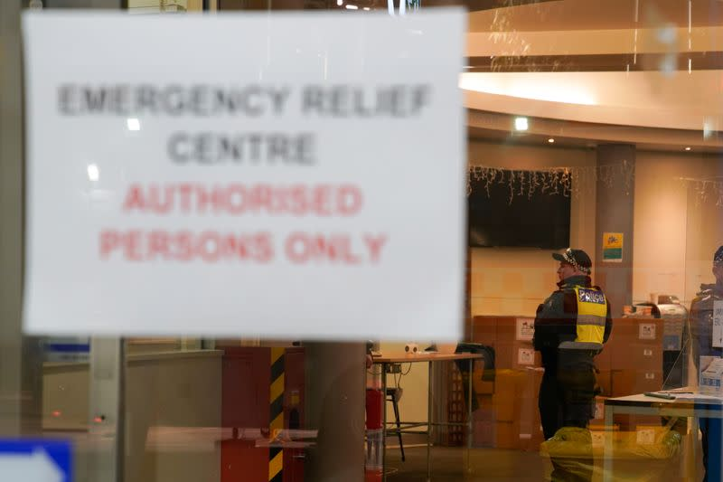 Police officers meet inside an emergency relief centre outside a locked down public housing tower in response to a COVID-19 outbreak in Melbourne