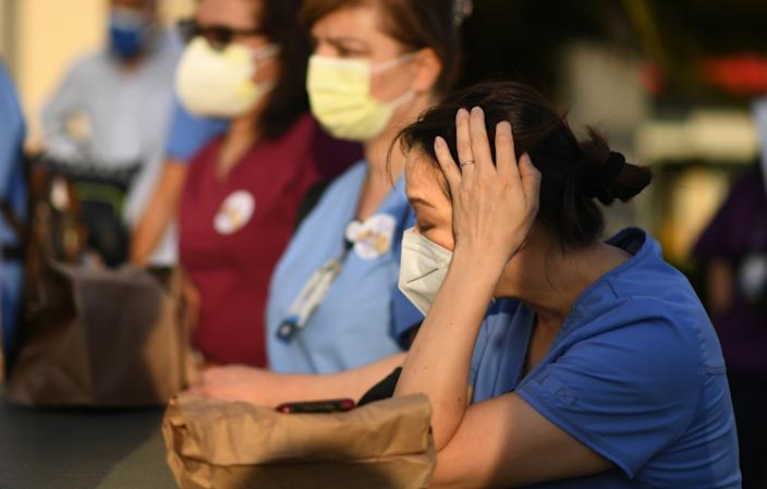 "Nurses attend a candlelight vigil for nurse Celia Marcos outside Hollywood Presbyterian Medical Center in Los Angeles Wednesday. Marcos died from the coronavirus. <span class=""copyright"">(Wally Skalij / Los Angeles Times)</span>"