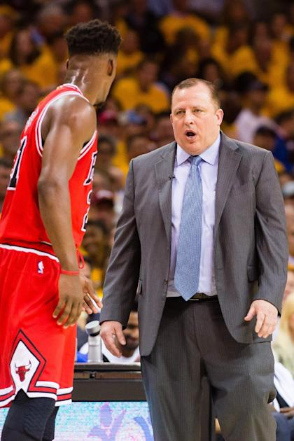 Bulls coach Tom Thibodeau (right) speaks with guard Jimmy Butler during Game 1 against the Cavaliers. (Getty Images)