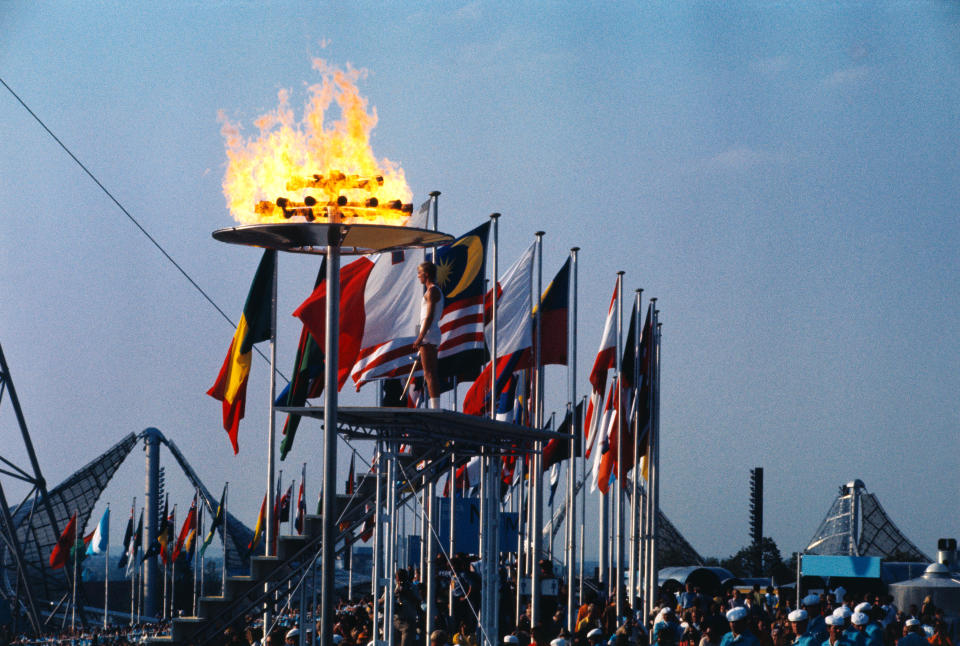 Gunter Zahn stands after lighting the Olympic flame