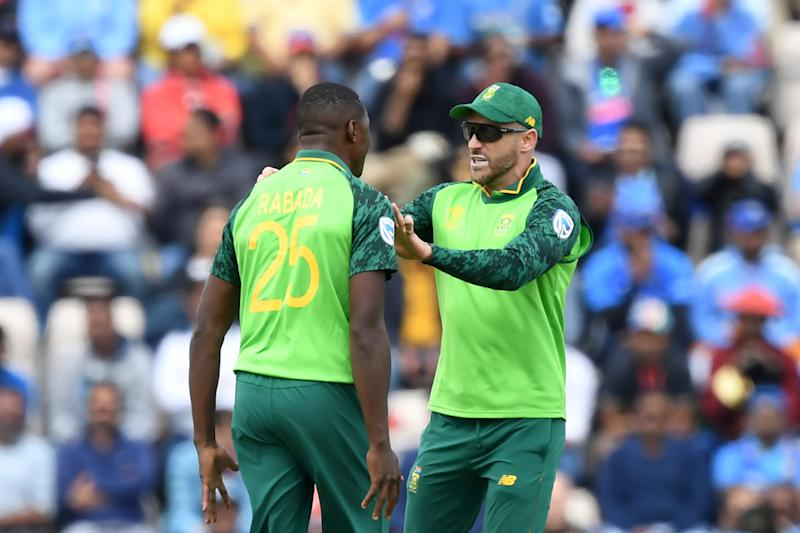 South Africa's Kagiso Rabada (L) celebrates with South Africa's captain Faf du Plessis after taking the wicket of India's Shikhar Dhawan for eight during the 2019 Cricket World Cup group stage match between South Africa and India at the Rose Bowl in Southampton, southern England, on June 5, 2019. (Photo by Dibyangshu SARKAR / AFP) / RESTRICTED TO EDITORIAL USE (Photo credit should read DIBYANGSHU SARKAR/AFP/Getty Images)