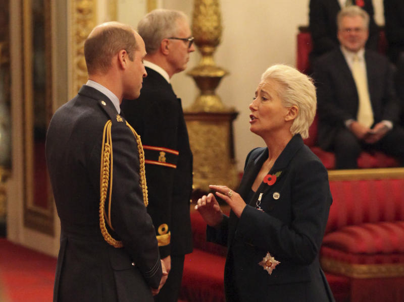 Emma Thompson accepts damehood wearing trainers, equal pay badge and trouser suit