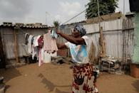 Woollams Ablavi, 61, a resident of Baguida, hangs clothes up to dry at her home in Baguida