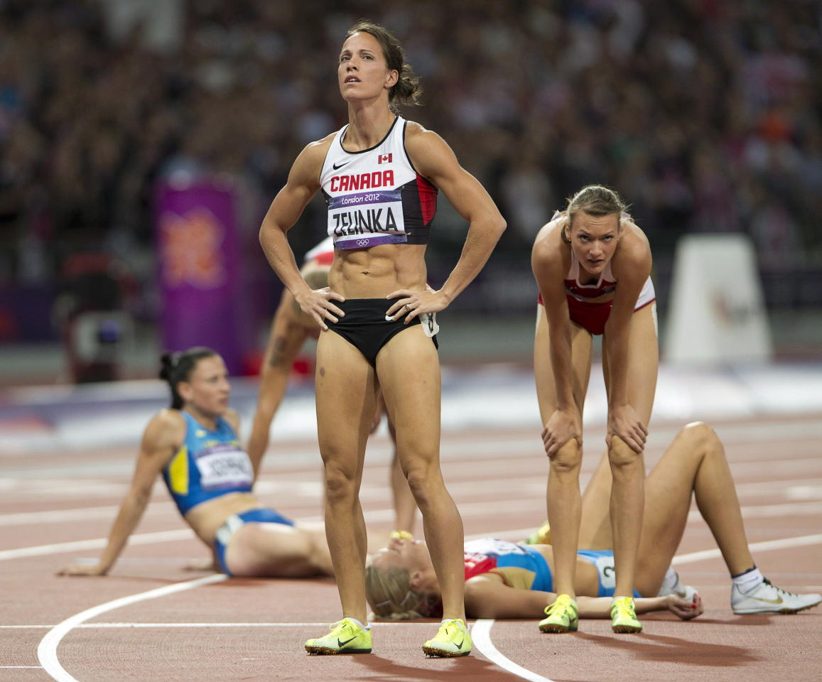 Canada's Jessica Zelinka looks at her results of the 800-metre event of the women's heptathlon after finishing in sixth place at the 2012 Summer Olympics in London on Saturday, August 4, 2012. THE CANADIAN PRESS/Ryan Remiorz