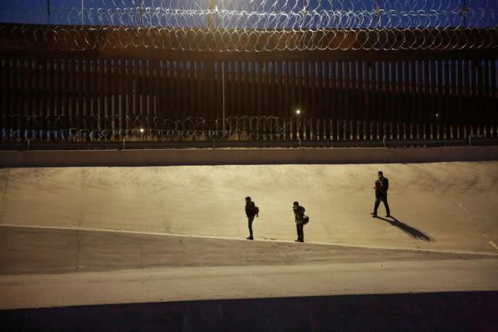 Migrants are seen after crossing the Rio Bravo river to turn themselves in to U.S. Border Patrol agents to request for asylum in El Paso, Texas, U.S., as seen from Ciudad Juarez