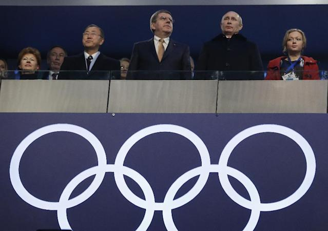 Russian President Vladimir Putin, second from right, International Olympic Committee President Thomas Bach, centre, and United Nations Secretary-General Ban Ki-moon, third from left, attend the opening ceremony of the 2014 Winter Olympics in Sochi, Russia, Friday, Feb. 7, 2014. (AP Photo/Mark Humphrey)