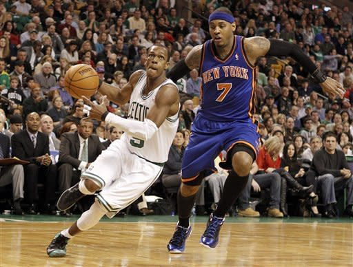 Boston Celtics point guard Rajon Rondo drives past New York Knicks' Carmelo Anthony (7) during the second quarter of an NBA basketball game in Boston on Friday, Feb. 3, 2012. (AP Photo/Winslow Townson)