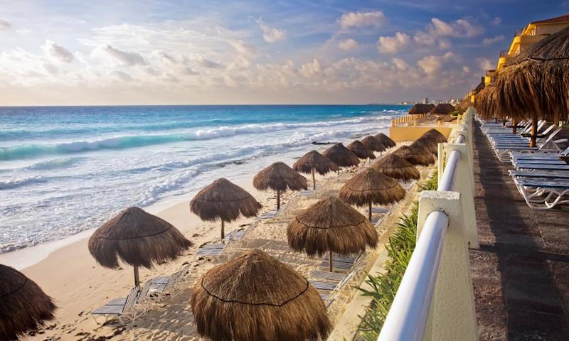 The turquoise waters and white sand beaches of Cancún. For workers drawn from impoverished southern states, wages are low.