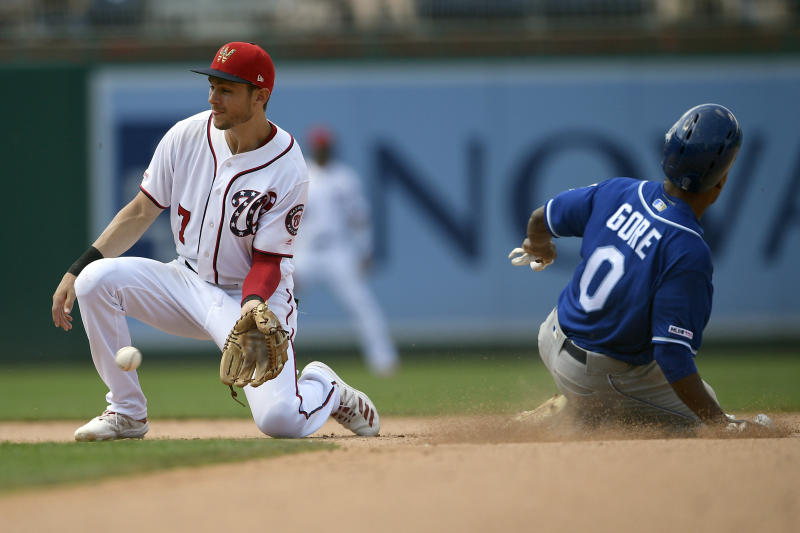 Washington Nationals shortstop Trea Turner (7) waits for the ball as Kansas City Royals' Terrance Gore (0) steals second base during the eighth inning of a baseball game, Sunday, July 7, 2019, in Washington. (AP Photo/Nick Wass)